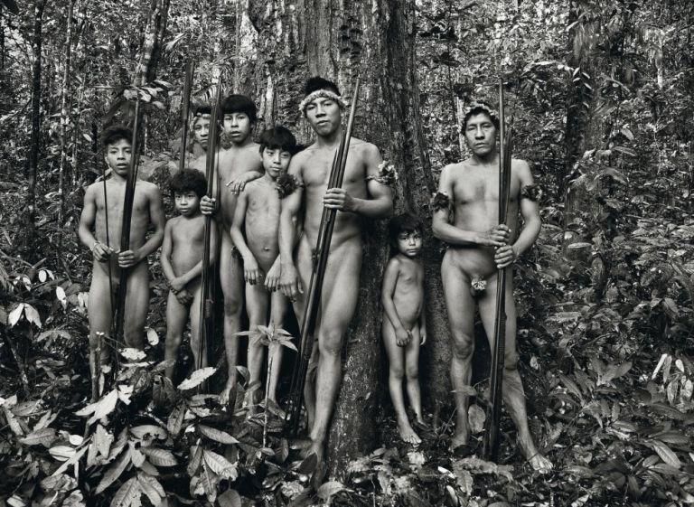 Awá men and boys, in the Território Indígena Awá, in the Brazilian Amazon by Sebastião Salgado
